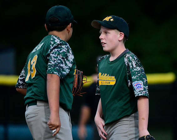 8/10/2018 Mike Orazzi | Staff New Jersey's Gaetano Alfano (13) and Timmy Naughton (11) during the Eastern Regional Little League Tournament at Breen Field in Bristol Friday night.