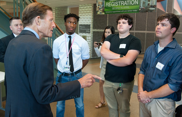 08/10/18 Wesley Bunnell | Staff Senator Richard Blumenthal speaks to advanced manufacturing students from programs in the CSCU system including Shawn Burgos, 3rd from L, and Dale Twigg, far right, during his visit to Tunxis Community College on Friday. The Senator spoke about the importance of the new advanced manufacturing program offered by the school and the demand for advanced manufacturing jobs within Connecticut.