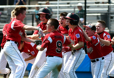 8/10/2018 Mike Orazzi | Staff Rhode Island celebrates a down 5-0 in the bottom of the 6th, 6-5 win over New Hampshire to advance to the New England final with Massachusetts at Breen Field