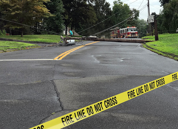 8/1/2018 Mike Orazzi | Staff Wires down on Garfield Street in Bristol Wednesday afternoon, causing several power outages in area.