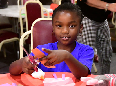 8/1/2018 Mike Orazzi | Staff Walnut Orange Walsh NRZ Community Learning Center's Kimora Billie while making crafts at the New England Carouse Museum Wednesday afternoon.
