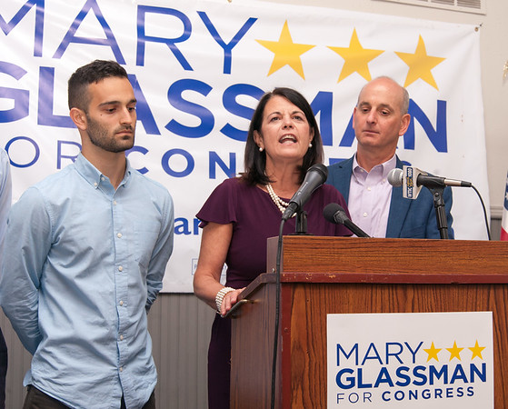 08/14/18 Wesley Bunnell | Staff Democratic Candidate for Connecticut's 5th Congressional District Mary Glassman surrounded by her son Sam, L, and husband Andrew, makes her concession speech at her campaign night headquarters at The Kitchen on Tuesday night in New Britain.