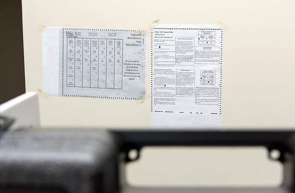 08/14/18 Wesley Bunnell | Staff Instructions on how to enter entries into the voting ballot along with a sample Republican ballot are taped to the wall behind a voting station at voting district 5-1 at the School Apartments on Bassett St on Tuesday afternoon.