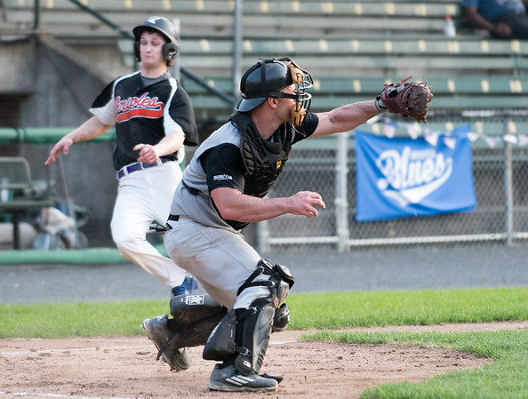 08/16/18 Wesley Bunnell | Staff The Bristol Knights vs the Cromwell Orioles in a Twilight League Baseball elimination game on Thursday night at Muzzy Field. Catcher Justin Martella (13) fields a throw up the first base line on a play at home.
