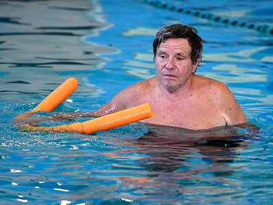 8/16/2018 Mike Orazzi | Staff Lou Spranzo participates in an aquatics class at the Plainville YMCA Thursday morning.