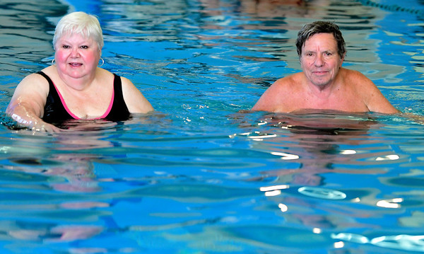 8/16/2018 Mike Orazzi | Staff Wilma Michaud and Lou Spranzo participate in an aquatics class at the Plainville YMCA Thursday morning.