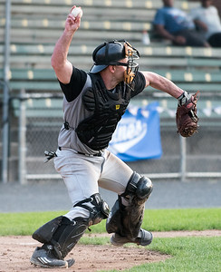 08/16/18  Wesley Bunnell | Staff  The Bristol Knights vs the Cromwell Orioles in a Twilight League Baseball elimination game on Thursday night at Muzzy Field. Catcher Justin Martella (13) throws to third base for the out after fielding the throw on the first base side of home plate.