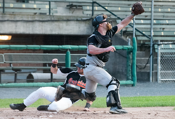 08/16/18 Wesley Bunnell | Staff The Bristol Knights vs the Cromwell Orioles in a Twilight League Baseball elimination game on Thursday night at Muzzy Field. Catcher Justin Martella (13) fields a high throw on a play at home.
