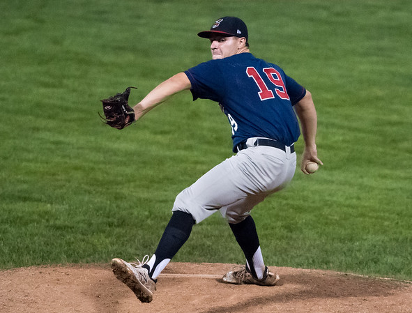 08/16/18 Wesley Bunnell | Staff The Newington Indians vs the Cromwell Orioles in a Twilight League Baseball best of 3 championship game on Thursday night at Muzzy Field. Newington starting pitcher John Amendola (19).