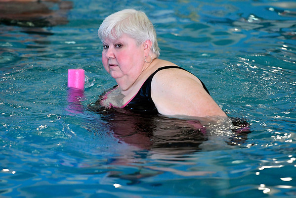 8/16/2018 Mike Orazzi | Staff Hazel Koons participates in an aquatics class at the Plainville YMCA Thursday morning.