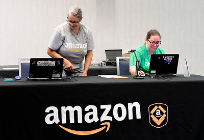 8/17/2018 Mike Orazzi | Staff Amazon representatives Cindy Pastore and Amber Tremblay during a hiring event at the DoubleTree by Hilton Hotel in Bristol for Amazon's new delivery station on Friday morning.
