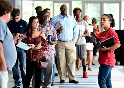 8/17/2018 Mike Orazzi | Staff Amazon representatives Sierra Rogers (right) directs applicants during a hiring event at the DoubleTree by Hilton Hotel in Bristol for Amazon's new delivery station on Friday morning.
