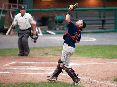 08/17/18  Wesley Bunnell | Staff  The Newington Indians vs the Cromwell Orioles in the Twilight League Baseball Championship Series on Friday night at Muzzy Field. Eric Jaillet (31) catches a pop up near home plate.