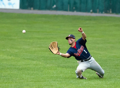 08/17/18  Wesley Bunnell | Staff  The Newington Indians vs the Cromwell Orioles in the Twilight League Baseball Championship Series on Friday night at Muzzy Field. Chris Aleman (1) with a sliding catch for the out in center field.