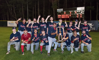 08/17/18  Wesley Bunnell | Staff  The Newington Indians vs the Cromwell Orioles in the Twilight League Baseball Championship Series on Friday night at Muzzy Field. Coach Keith Echevarria holds the championship trophy.