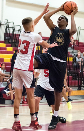 08/02/18 Wesley Bunnell   Staff REIS Academy (New Britain) defeated Portland in a Nutmeg Games 9th grade boys basketball contest on Thursday evening at New Britain High School. Chris Harper (22).