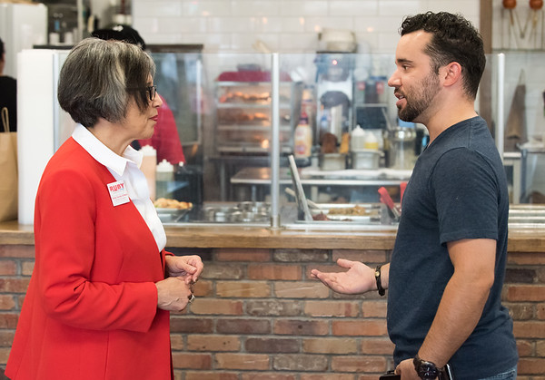 08/02/18 Wesley Bunnell | Staff Ruby Corby O'Neill speaks with owner of Mofongo Restaurant Vincent Placeres at his restaurant on Thursday afternoon. O'Neill is running for for Congress for Connecticut's 5th district.