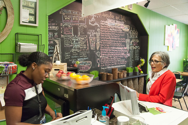 08/02/18 Wesley Bunnell   Staff Ruby Corby O'Neill places an order at Sweetwater Juice Bar & Deli on Thursday afternoon with Manager Jazmine Schand during a stop on her tour of downtown New Britain. O'Neill is running for for Congress for Connecticut's 5th district.