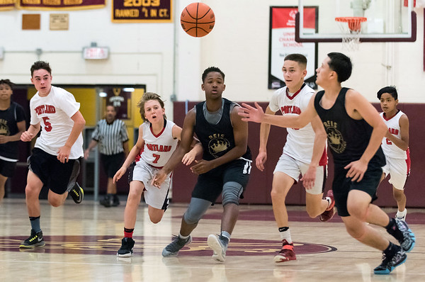 08/02/18 Wesley Bunnell | Staff REIS Academy (New Britain) defeated Portland in a Nutmeg Games 9th grade boys basketball contest on Thursday evening at New Britain High School. Players including Fabian Negron (2), far R, track down a loose ball mid court.