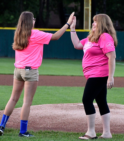 8/2/2018 Mike Orazzi   Staff Bristol Blues' Alyssa Masi high fives Debbie McPhee after McPhee threw out one of the first pitches at Muzzy Field during Pink Night Thursday evening.
