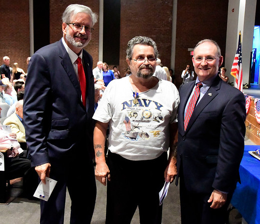 8/2/2018 Mike Orazzi   Staff Joseph Tierpack (center) receives his wartime service medal from state Reps. William Petit and State Sen. Henri Martin during the Connecticut Wartime Service Medal presentation ceremony at Bristol Eastern High School Thursday afternoon. Connecticut veterans who served 90 or more days of active federal wartime service - unless the war or operation lasted less than 90 days - or any member of any reserve component of the armed forces, including the National Guard, who served during a period of war and was honorably discharged from active duty or was honorably discharged from a reserve component and was a resident of this state either at the time he or she was serving or is living in this state on the date of such award.