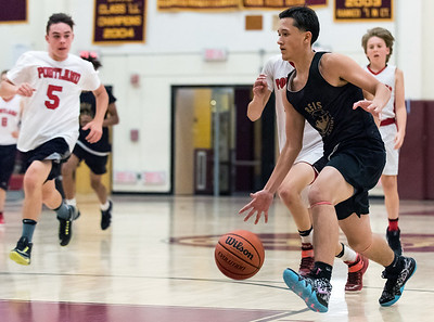 08/02/18  Wesley Bunnell | Staff  REIS Academy (New Britain) defeated Portland in a Nutmeg Games 9th grade boys basketball contest on Thursday evening at New Britain High School. Fabian Negron (2) drives to the basket.