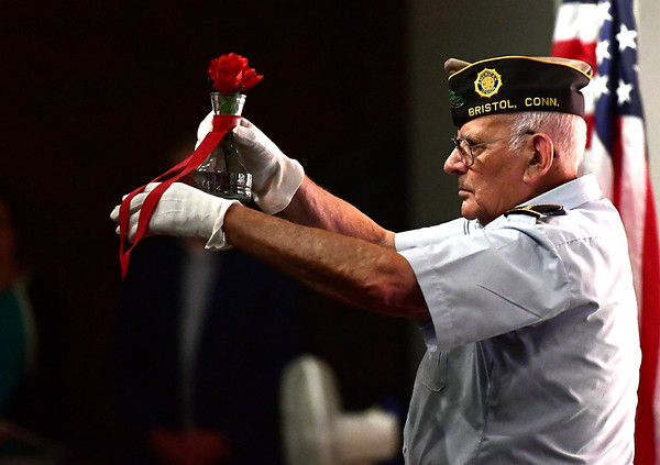 8/2/2018 Mike Orazzi   Staff Chuck Bouffard during the Connecticut Wartime Service Medal presentation ceremony at Bristol Eastern High School Thursday afternoon. Connecticut veterans who served 90 or more days of active federal wartime service - unless the war or operation lasted less than 90 days - or any member of any reserve component of the armed forces, including the National Guard, who served during a period of war and was honorably discharged from active duty or was honorably discharged from a reserve component and was a resident of this state either at the time he or she was serving or is living in this state on the date of such award.