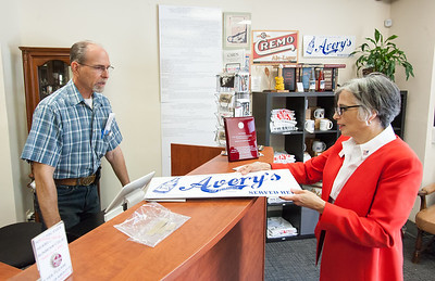 08/02/18  Wesley Bunnell | Staff  Ruby Corby O'Neill speaks with New Britain Industrial Museum volunteer Roger Thorin as she buys a Avery's Sods sign during a stop on her tour of downtown New Britain. O'Neill is running for for Congress for Connecticut's 5th district.