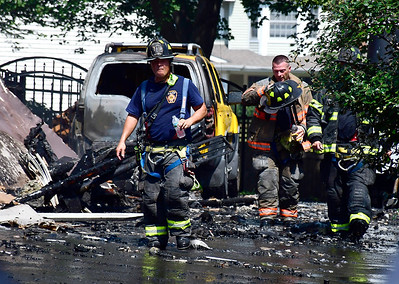 8/28/2018 Mike Orazzi | Staff Bristol and area firefighters on scene of a structure fire at 366 Village Street in Bristol Tuesday morning. Two adults, two children and one dog were displaced by the late morning blaze.