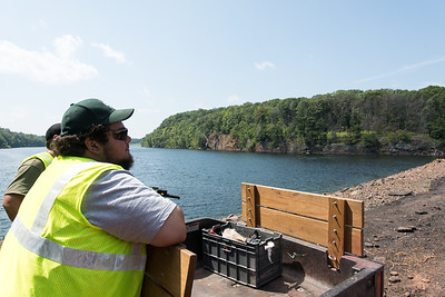08/29/18  Wesley Bunnell | Staff  Utility worker Derick Brown keeps an eye out for trespassers cliff diving at Shuttle Meadow Reservoir on Wednesday afternoon.
