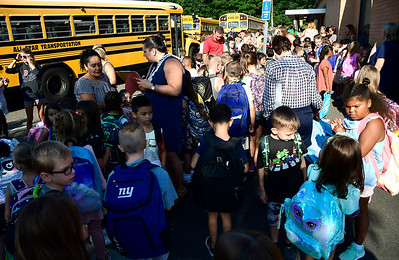 8/29/2018 Mike Orazzi | Staff Students arrive for the first day of school at the Fisher Middle School in Plymouth Wednesday morning.