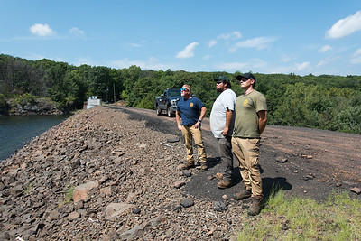 08/29/18  Wesley Bunnell | Staff  Head caretaker Dave Camden, L, Utility Worker Derick Brown and Utility Worker Justin Thompson look over the cliffs at Shuttle Meadow Reservoir on Wednesday afternoon for cliff jumpers.