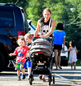 8/29/2018 Mike Orazzi | Staff Kimberly Palmieri arrives with her son Daniel Ames for his first day of kindergarten along with her other children Tyler and Alexis for the first day of school at the Fisher Middle School in Plymouth Wednesday morning.
