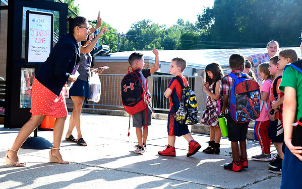 8/29/2018 Mike Orazzi | Staff Principal Kimberly Loveland welcomes students on the first day of school at the Fisher Middle School in Plymouth Wednesday morning.