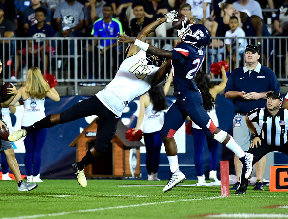 8/30/2018 Mike Orazzi | Staff UConn's Keyshawn Paul (24) and UCF's Gabriel Davis (13) at Rentschler Field in East Hartford Thursday night.
