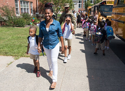 08/30/18  Wesley Bunnell | Staff  Shannon Royal holds hands with her son Shayne, as she is followed by daughter Jamya, husband Jeremy and sons Evan and Jeremy Jr , not seen, after the childrens first day of school at Lincoln Elementary School on Thursday afternoon.