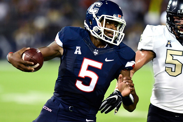 8/30/2018 Mike Orazzi | Staff UConn quarterback David Pindell (5) at Rentschler Field in East Hartford Thursday night.