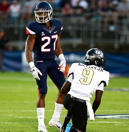 8/30/2018 Mike Orazzi | Staff UConn's Omar Fortt (27) during the season opening game with UCF at Rentschler Field in East Hartford Thursday night.