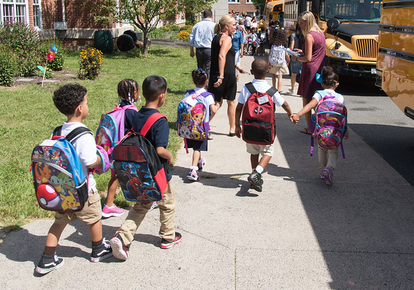 08/30/18 Wesley Bunnell | Staff Lincoln Elementary School Kindergartners walk out of school for their bus ride home after their first day of school on Thursday afternoon.