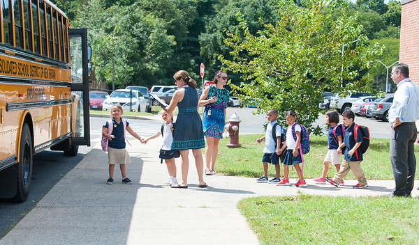 08/30/18 Wesley Bunnell | Staff Kindergartner Mia Scirpo, L age 5, holds hands with a friend as they exit Lincoln Elementary School at dismissal time of their first day of school on Thursday.