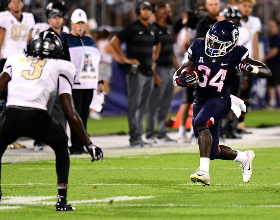 8/30/2018 Mike Orazzi | Staff UConn's Kevin Mensah (34) at Rentschler Field in East Hartford Thursday night.