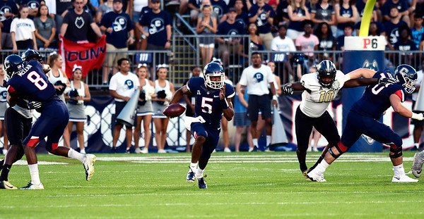8/30/2018 Mike Orazzi | Staff UConn quarterback David Pindell (5) during the season opening game with UCF at Rentschler Field in East Hartford Thursday night.