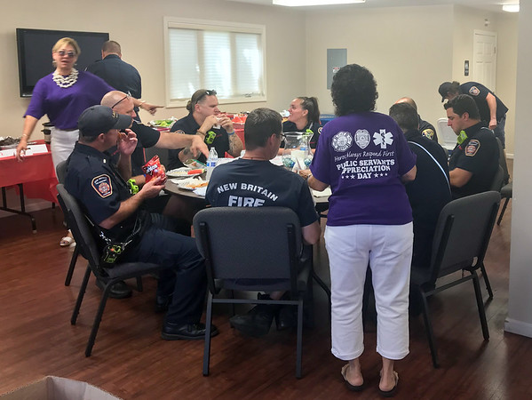 08/30/18 Submitted by Barbara M Thompson, Funeral Director/Embalmer New Britain Memorial - Sagarino Funeral Home held a free BBQ lunch for first responders on Thursday with over 70 served. Volunteers serve a table of New Britain firefighters and police.