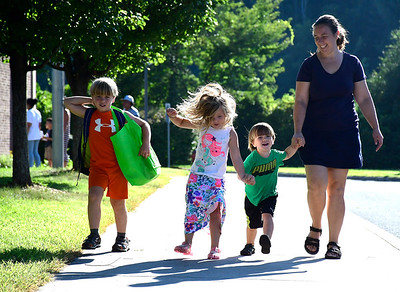 8/30/2018 Mike Orazzi | Staff Lisa Helming walks with her children Nathaniel,Christine and Samuel on the first day at the Mt. View School on Thursday morning.