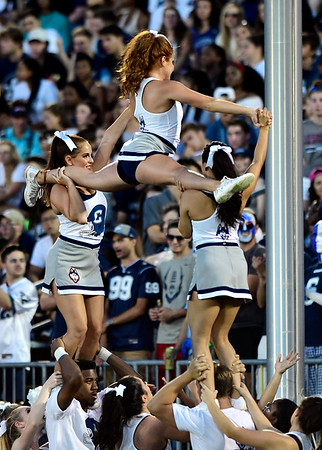 8/30/2018 Mike Orazzi | Staff UConn cheerleaders during the season opening game with UCF at Rentschler Field in East Hartford Thursday night.