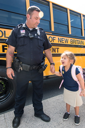 08/30/18 Wesley Bunnell | Staff New Britain Police Ofc. Peter Scirpo holds hands with daughter Mia, age 5, after her first day of kindergarten at Lincoln Elementary School on Thursday afternoon.