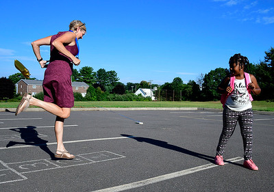 8/30/2018 Mike Orazzi | Staff Maura McGuire skips as Mt. View School first grade student K'Marie Owens looks on in Bristol Thursday morning.