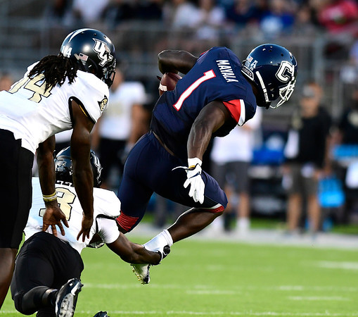 8/30/2018 Mike Orazzi | Staff UConn's Hergy Mayala (1) and UCF's Antwan Collier (3) at Rentschler Field in East Hartford Thursday night.