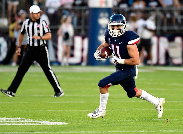 8/30/2018 Mike Orazzi | Staff UConn's Kyle Buss (11) at Rentschler Field in East Hartford Thursday night.