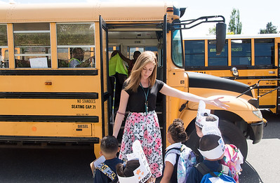 08/30/18  Wesley Bunnell | Staff  Lincoln Elementary School Kindergarten Teacher Kayla Montanaro helps students find their bus home after the first day of school on Thursday.